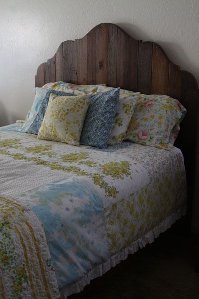 just love the big blocks of fabric on this quilt--made from vintage sheets