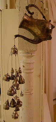 vintage silver teapot windchime with orphaned salt and pepper tops as chimes