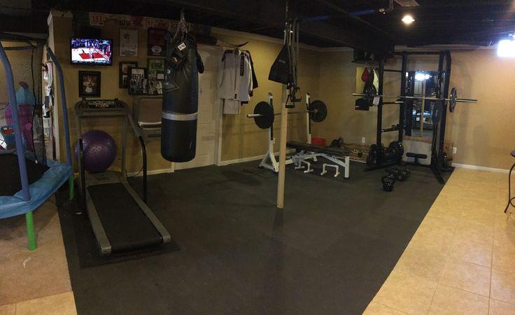 My basement gym.   Home gym. Treadmill. Heavy bag.  Speed bag.  Bench. Squat rack.   Pull up bar.