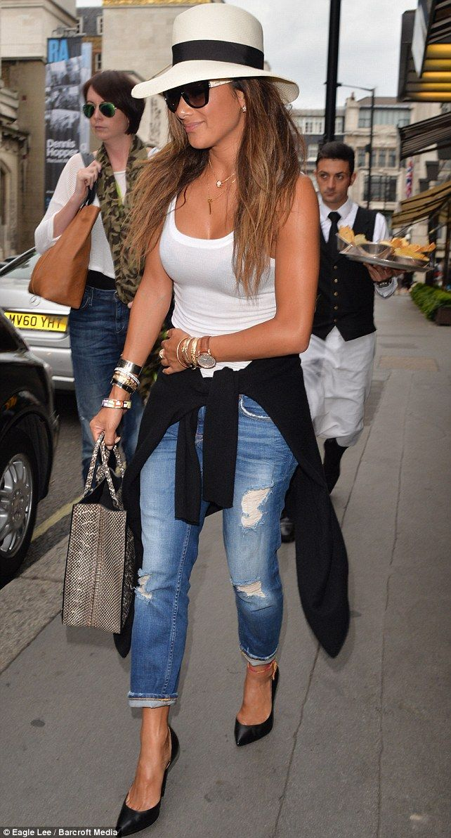 Hats off: Nicole kept things simple and stylish with a white vest top, ripped jeans, hat and black stilettos