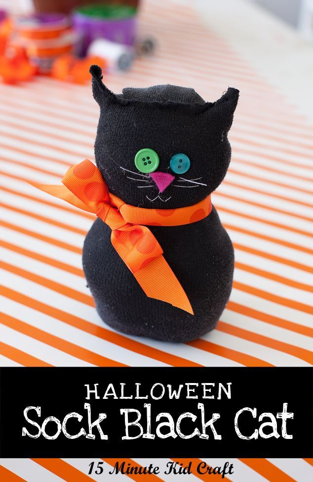 Halloween activities: 15 Minute Halloween Craft: Spooky Black Sock Cat - Make a quick Halloween craft with your kids using an old black sock, buttons and ribbon.