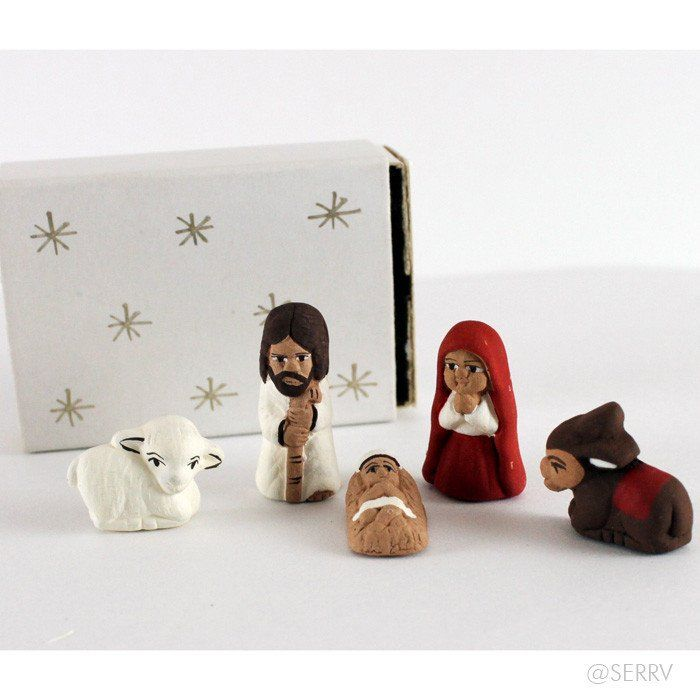 """Behold the tiniest nativity you will probably ever see- our Fair Trade Matchbox Nativity. Five tiny ceramic figures nestle perfectly inside a hand painted matchbox. An unique addition to a nativity collection or a perfect stocking stuffer. Handmade by artisans in Peru, a country that has a long and beautiful history of making ceramics. Box measures 2"""" W x 1.5"""" D"""