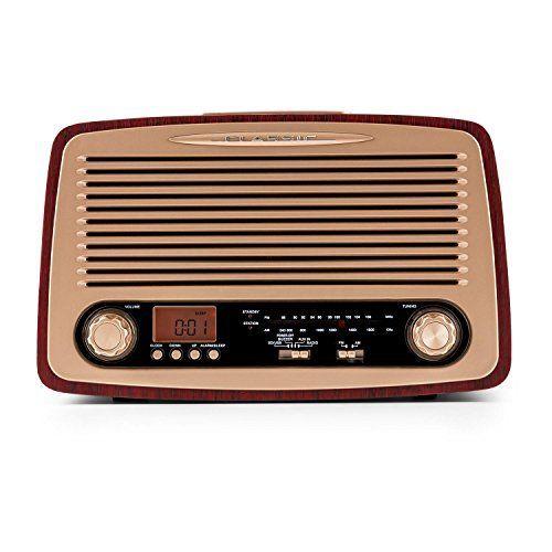 """La Dabby-Holly de oneConcept est une radio rétro aux multiples possibilités dont le charme vintage enchante les âmes nostalgiques sans qu'elles n'aient à se priver de technologie moderne. Le caractère de l'appareil est renforcé par les protections en tissus aux … <a href=""""http://www.123autos.fr/produit/oneconcept-dabby-holly-radio-style-retro-tuner-fmam-avec-ports-aux-usb-et-sd-pour-lecture-mp3-fonction-reveil-avec-alarme-programmable-affichage-lcd..."""