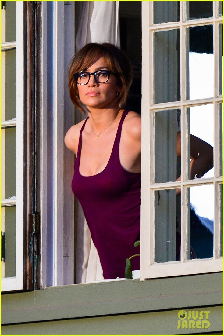 Jennifer Lopez dons dark-rimmed glasses while peering out a window and shooting scenes for her upcoming movie The Boy Next Door in Los Angeles. #Hollywood #Fashion #Style #Beauty