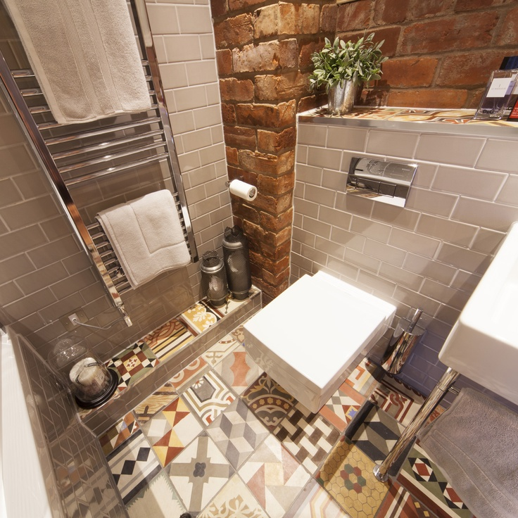 Gallery For Photographers Contemporary bathroom featuring Duravit sanitary ware and Samuel Heath chrome accessories with reclaimed encaustic and grey