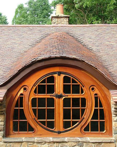 "an architect in PA was comissioned to build a little ""hobbit"" home. i love the this window. more pics in the article!"