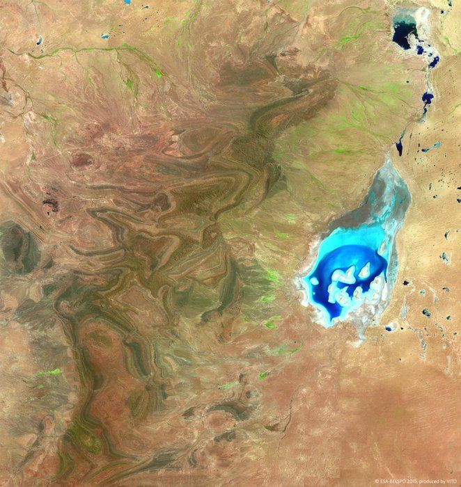 Lake Frome, one of the whitest salt lakes in the southern hemisphere is visible to the right. Unusually, this 12 February image shows it filled with brackish water that has flowed down the creeks in the area, which are typically dry.