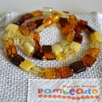 This unique premium amber necklace comes with a series of flat square amber in a mixed colour. Amber beads are finished in a polish compared to the standard bud range. The amber necklace is approx 45 cm in length. The Bambeado comes together with a plastic screw clasp. While Bambeado amber comes in several colours, the colour is just a matter of personal choice. The colours may vary slightly from the images on the website due to variations in the amber beads.