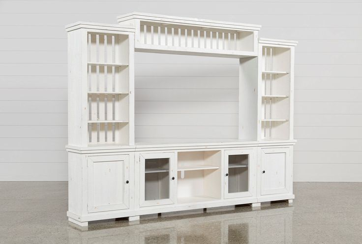 "Looking beachy and casual in a distressed white finish, our solid pine Sinclair 4-piece entertainment center brings charming texture and natural beauty to your living room. The media storage unit includes a 68"" TV stand, 2 storage piers and a bridge with shelving for accents. It's also adorned with understated pewter hardware and distinguished by airy slat details. #whitetvstands"