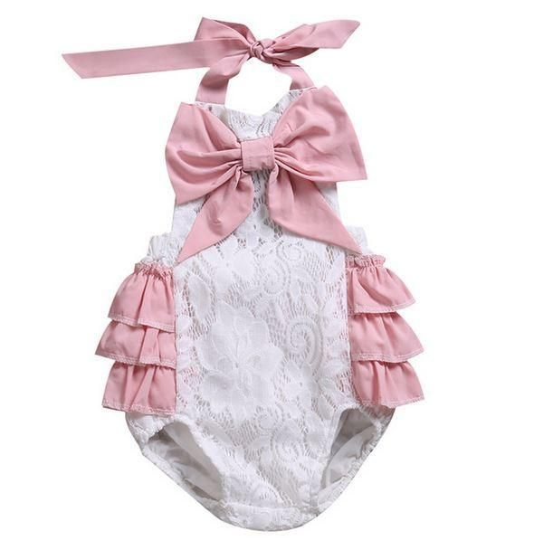 This Kryssi Kouture original features all of our favourites in just one piece! Soft rosette styled lace makes up this adorable romper, featuring a blush oversiz