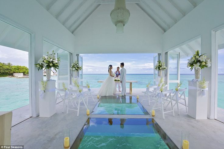 Brides can walk down a glass-bottomed aisle in a chapel-like venue that is just a few feet over a turtle enclosure in the stunning blue sea