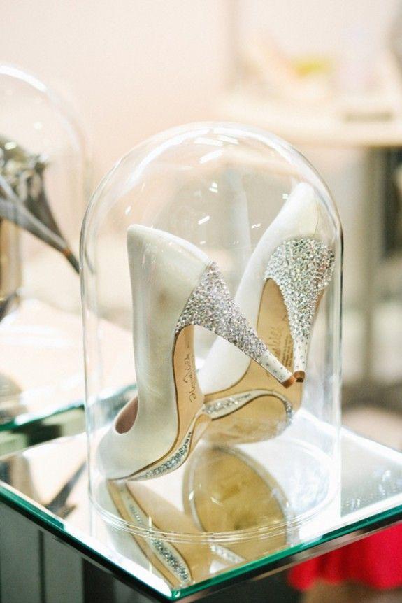 wedding shoe display like Cinderella's glass slipper
