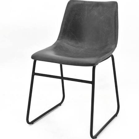 By-boo Stoel Logan Zwart  Description: De By-Boo Stoel Logan Zwart heeft een stoere en industriële uitstraling. De zitting is gemaakt van zwart leer en de stoel heeft een onderstel van zwart metaal.Door zijn eenvoudige uitstraling en neutrale kleur past de stoel in veel verschillende interieurstijlen. De Logan is zeer geschikt als eetkamerstoel maar kan ook uiteraard een plekje krijgen in de woonkamer.De afmetingen van de stoel zijn 81x46x44 cm. De Stoel Logan is ook verkrijgbaar in de…
