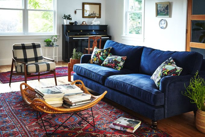 Love this couch! And the intense blue-ness moderates the intense red-ness that so many Persian rugs have. Also, that coffee table: a way to corral the books and papers! (maybe)
