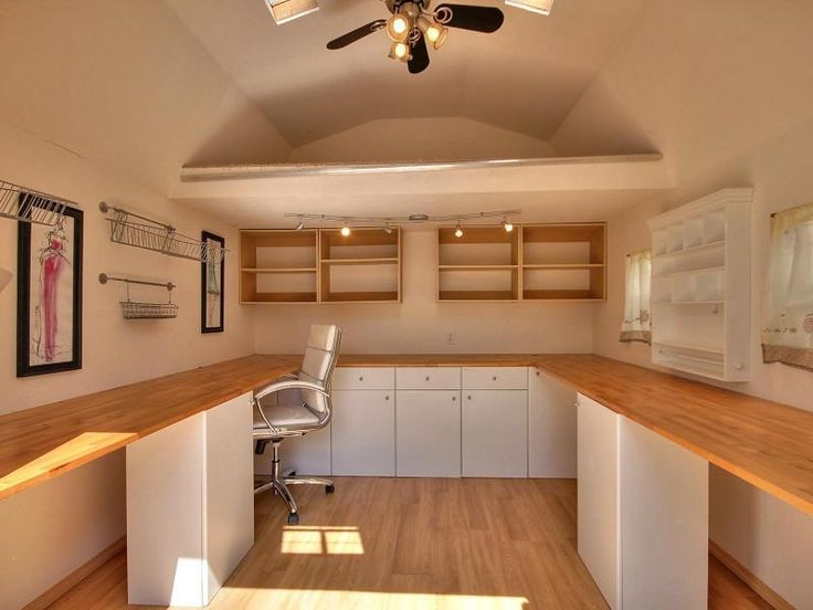 Contemporary Home Office with Ceiling fan, Built-in bookshelf, Hardwood floors, High ceiling, flush light