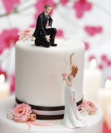// Reaching Bride and Helpful Groom Wedding Cake Toppers