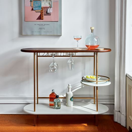 Shake things up at home with our Tiered Bar Console, complete with three tiers of storage and open glassware rack   shop now at west elm