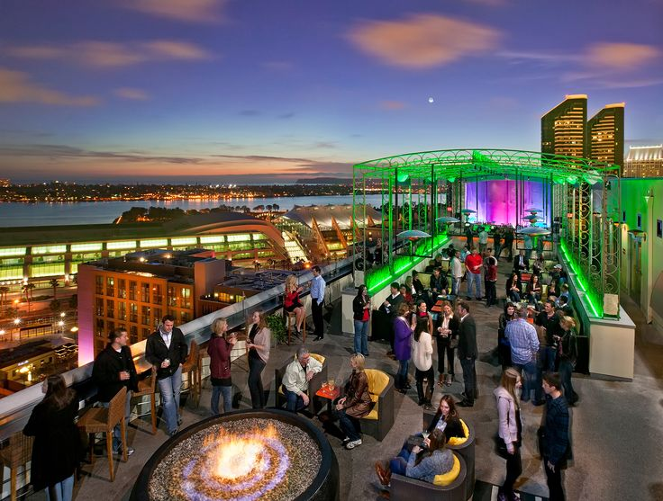 ALTITUDE SKYBAR The Marriott Gaslamp Quarter Hotel's rooftop bar, offers a swank way to take in a 180-degree view of downtown, Coronado, the bay, and the Padres (if they're playing a home game at Petco Park). Come in the late afternoon to lounge around the lava-rock fire pit and sip down a specialty Cosmo or martini as you watch the sun go down.