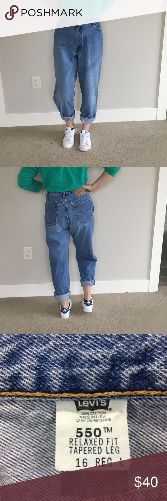 Vintage Levi's 550 High Waisted Mom Jeans Tapered In good condition for their age, but they do have some Wear to the bottom of the pant legs as well as a small hole near the belt loop on the back (view picture). Flat waist measurement was used to convert these to a modern size 32. **please note that the model is actually a size ~27 and gathered the jeans in the back to show what they would look like if they fit Levi's Jeans