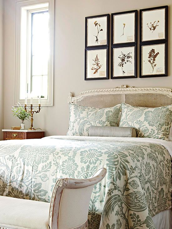 The painted antique bed and the framed botanical art display make for a peaceful bedroom retreat. #retreat #bedroom #interiordesign