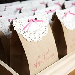 Paper doilies and ribbon transform plain kraft paper bags into oh-so-sweet party…