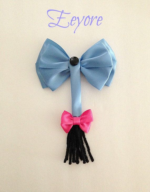 This listing is for a Disney inspired Eeyore hair bow. It is handmade by me. The bow is made with blue satin. It measures about 4 inches long and about 3 inches wide (excluding tail). This bow is attached to a french barrette. This Eeyore bow would be great to wear on that magical vacation to Disneyland, Disney World or a Disney cruise!!! It would also be great for the birthday girl to wear on her special day!!! I also do custom orders so if you dont find what you want message me the…