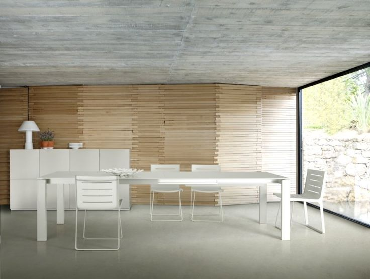 The Stunning Bianco Dining table by C Dondoli & M Pocci in 2010 extends to double it size with the aid of three additional extension leaves. Its vital statistics are h75 x w95 x l150/200/250/300 cm. Available in White and Argile glass and Aluminium or White Laminate version.