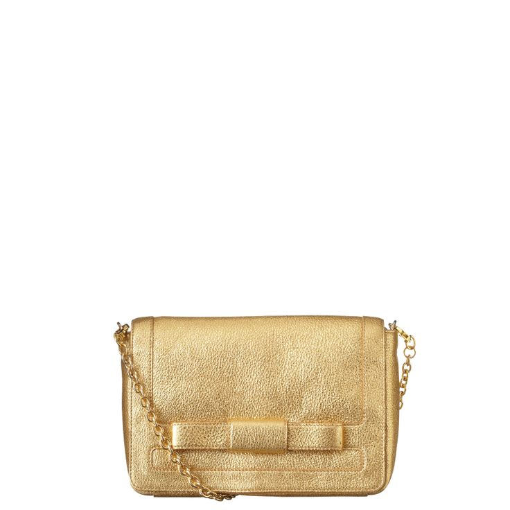 Orla Kiely: Gold sparkle leather bag with front bow detail. Magnet to close. Adjustable chain and leather long strap that can be worn across the body or over the shoulder. Inside details include brown linear stem jacquard lining, small zip pocket, key chain and mobile pockets. Long chain strap measures 106cm.