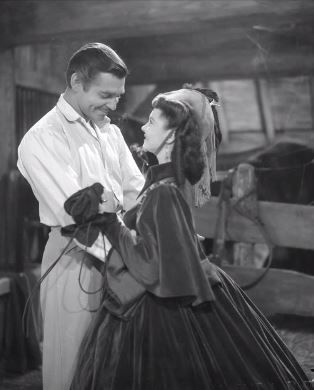 Clark Gable and Vivien Leigh in Gone With the Wind. Scarlett visits Rhett in the army jail.