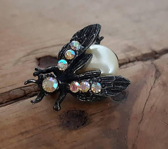Check out this item in my Etsy shop https://www.etsy.com/au/listing/532579178/vintage-bee-wasp-brooch-aurora-borealis