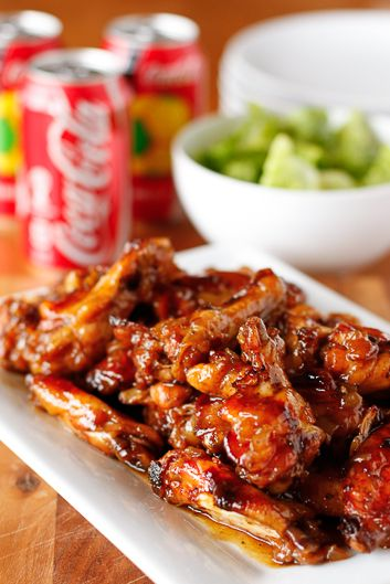 Baked Chicken Wings -- don't miss these crispy Coca-Cola baked chicken wings smothered in a delicious sweet and tangy sauce, perfect for game day and beyond!