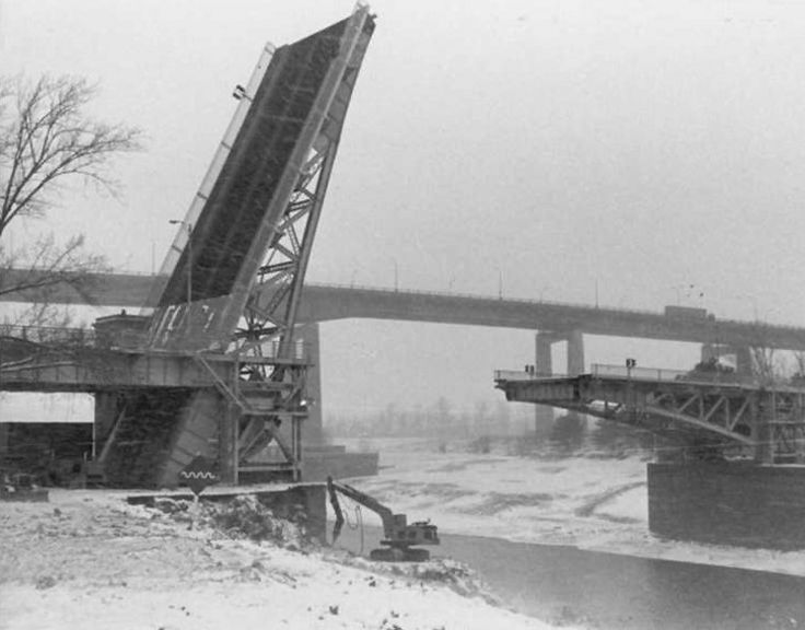 St. Catharines, Ontario Maintenance of the Homer Bridge over the Welland Canal, part of the St. Lawerence Seaway system. Skyway in background Still in use today. -Fun side note, my dad used to operate this bridge.