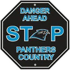 """Carolina Panthers Plastic Stop Sign """"Danger Ahead Panthers Country"""" by Fremont Die. $12.09. This Carolina Panthers stop sign is made of durable styrene plastic and measures approximately 12"""" x 12"""", the same size and shape as a real stop sign. Reads """"Danger Ahead STOP Panthers Country"""". Featuring vibrant team colors and logos, this sign is a great decoration for any Panthers fan's home, inside or out."""