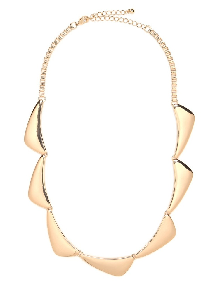 We're mad for the sleek and minimal undercurrent that pulses behind this gorgeous statement style. While it features a bevy of luxe gold triangle accents, the resulting look is superbly sexy and street-chic.    This is part of the ELLE Holiday Shop