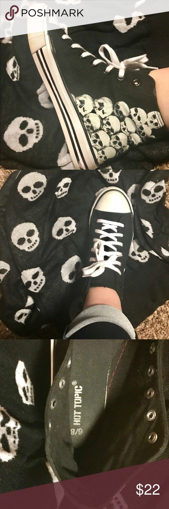Women's hi-Top Sneakers Bring out the goth in all of us and indulge in these grunge style skull kicks. Have only been worn a handful of times. Almost perfectly clean besides the bottoms are not perfect and my son drew a red line on the inner sole of the right shoe but I cleaned it and covered up w a nail polish pen the best I could. Other than that, they are like new. Hot Topic Shoes Sneakers