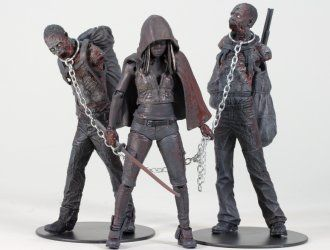 Michonne with Zombie Pets 3 Pack Figure Set from The Walking Dead. It is made by McFarlane Toys and is approximately 13 cm (5.1 in) high  http://film-tv.minimodelfilmstuff.co.uk/film-tv-collectable/the-walking-dead-figure-set-mcfarlane-toys-14481  Comes with removeable arms and jaws, backpacks and chains.  This bloody black & white 3-pack box set includes Michonne & her two zombie pets. Michonne is the mysterious stranger who saves Andrea from walkers with her katana blade and t...