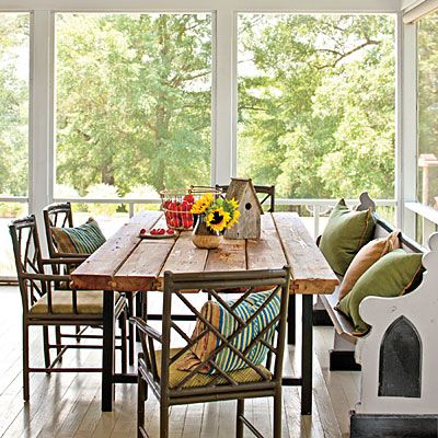 Porch Dining Area | Antique Church Pew | Georgia Harvest Tables heart pine table | Southern Living