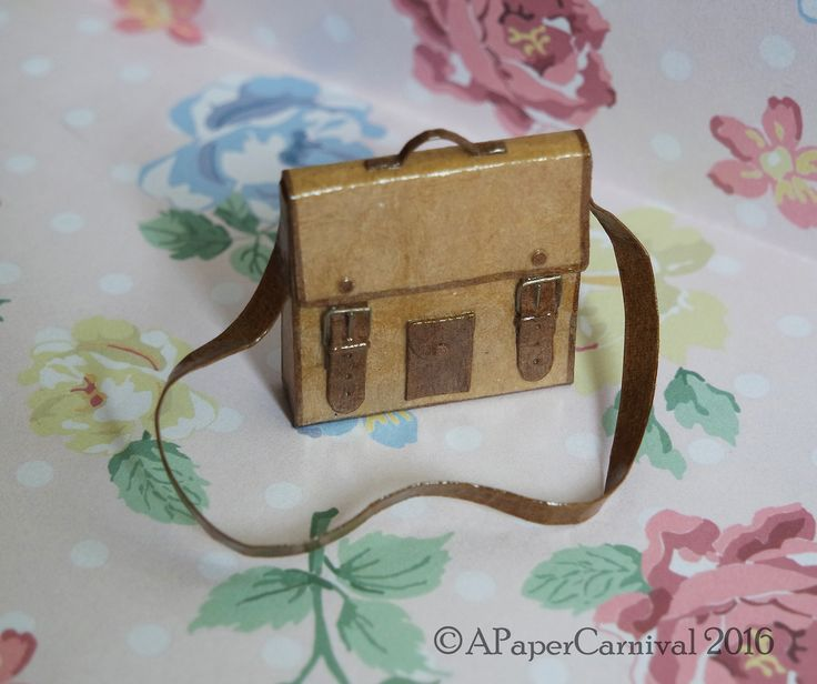 Handmade by Rachel Prout. A vintage Messenger Bag constructed from card, raffia and (reluctantly!) wire.