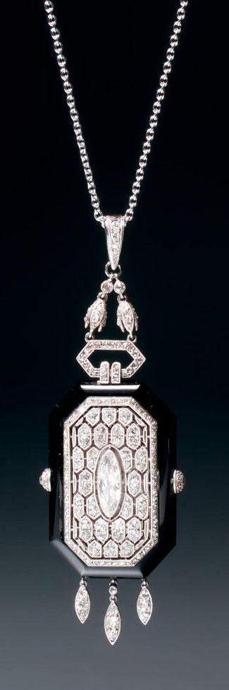 BOUCHERON - A very rare Art Deco onyx and diamond pendant watch (hva)
