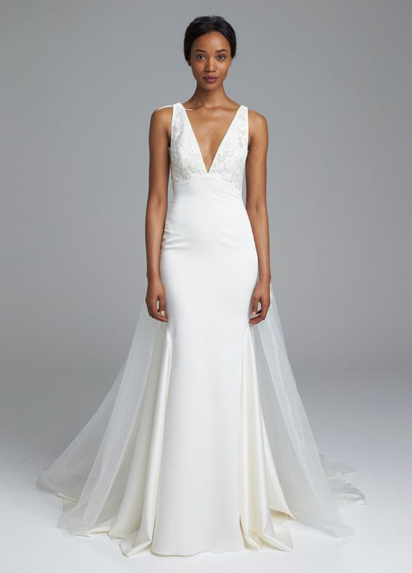 The 9 Biggest Bridal Trends For Spring 2017: Dramatic Deep-V This is how you show skin at your wedding without revealing too much. Kenneth Pool Spring 2017