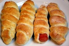 I made these with Hebrew National Hot Dogs and they are fabulous and easy. If you like pigs in a blanket these are much better than the normal pop a croissant can open and roll a hotdog. We dip ours in mustard or ketchup!
