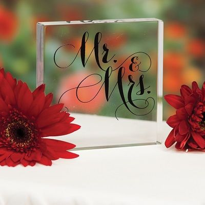 Square acrylic cake top with Mr. & Mrs. design.