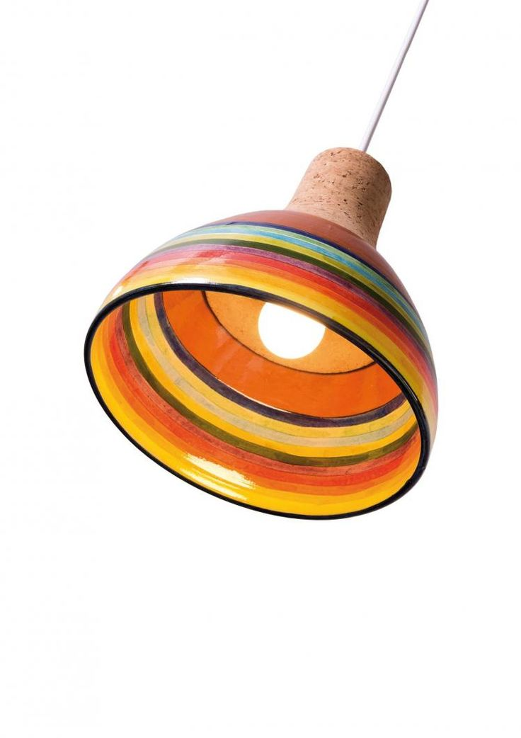A cork ceiling lamp featuring a moulded, handpainted clay lampshade.  The manually turned cork softly grips the lampshade. The weight of the clay helps to optimize how the lamp hangs. The colours and motifs revealed are part of the symbolism of the Algarve's heritage, and in particular its Moorish history.