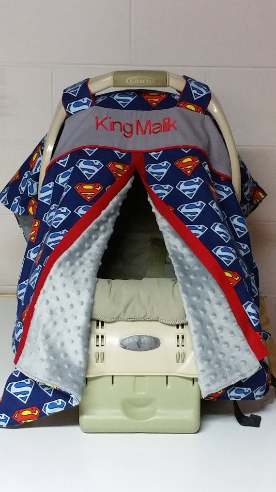 This listing is for an infant carseat canopy. Open front style for easy access to child.  The outside is superman print, trimmed in red cotton fabric and lined with soft gray minky fabric. Handles have velcro closures.  Please send me a message with the childs name to be printed on the carseat canopy.