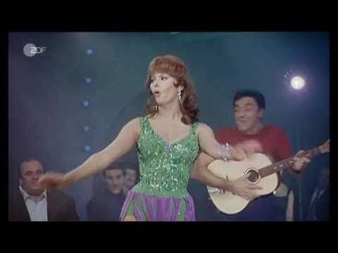 """this is retro vintage film of neopolitan, italian beauty and actress Sophia Loren performing and singing the neopolitan song, """"Tu vuo fa L´Americano"""". video clip is in german language but Sophia Loren sings in Italian (neopolitan dialect). love you Sophia Loren!! xoxo. video clip is courtesy of www.youtube.com."""