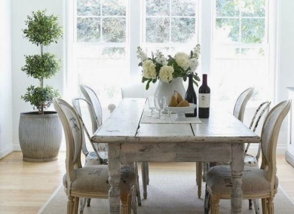 French Farmhouse Table In A Light Filled Breakfast Room