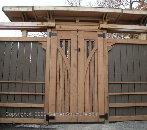 Another Cedar Fence - this time with an asian flair. Beyond these gates, much like in a chinese temple is a wall, supporting a similar but much larger headpiece. Beyond that a hot tub. When they built the temples they had this layout to create a bottleneck for invading armies.