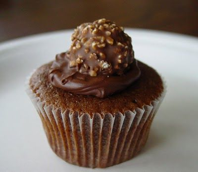 Ferrero Rocher Cupcakes--Hershey's Syrup cupcake recipe, filled with Nutella, and topped with Ferrero Rocher (hazelnut filled truffle).