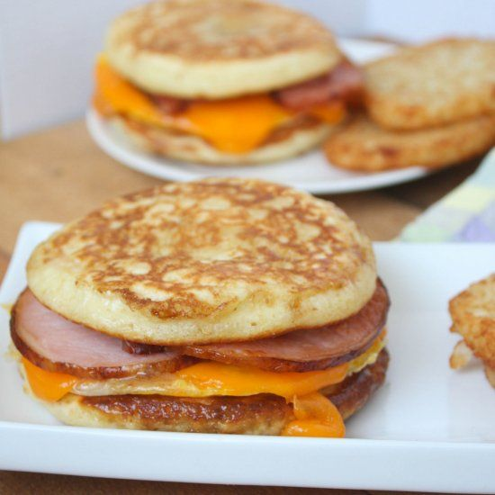 A take on the delicious McGriddle: fried egg, cheese and bacon sandwiched between two maple syrup-soaked pancakes.