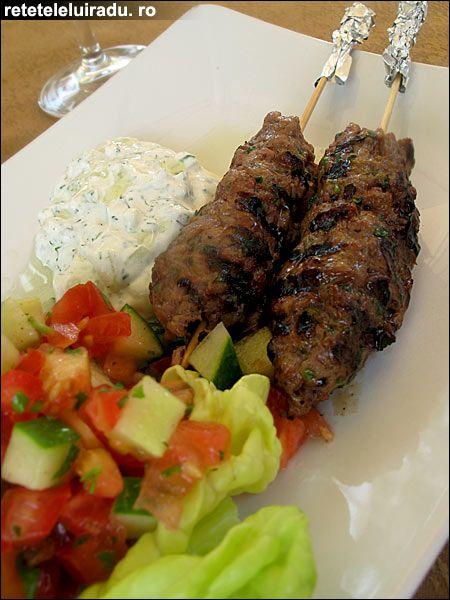 Lamb kofte kebab with minty yogurt sauce.